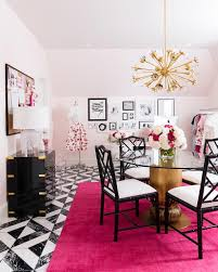 feminine pink and white home office boasts black bamboo chairs seated around a center entry table gold positioned on a lulu georgia ohio magenta rug black and white home office