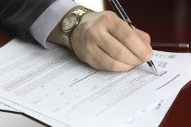 Male Hand In A <b>Business Suit</b> Holding A <b>Pen</b> And Preparing To Sign ...