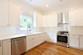 Hardwood Or Tile In Kitchen Off White Cabinets White Subway Tile Large Kitchen Design With