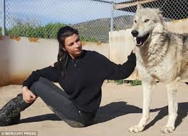 Models left 'unfulfilled' by the catwalk post charity photos on ... The pair, including Los Angeles-based Destiny, 26, above visitng a wolf