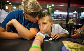 Attention Disorder or Not  Children Prescribed Pills to Help in     The New York Times Amanda Rocafort and her son Quintn in Woodstock  Ga  Quintn takes the medication Risperdal  Credit Bryan Meltz for The New York Times