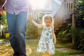 stay at home dad when fathers take off from work father and daughter walking in backyard