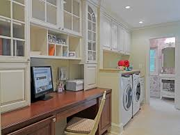 home office flooring laundry room traditional with baseboards built in desk beautiful bright office