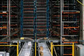 food value network issues packages move along conveyors into a large metal storage enclosure symbotic engineers call the box
