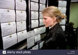 teenage girl looking at job adverts in careers shop uk stock photo stock photo teenage girl looking at job adverts in careers shop uk