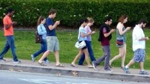 Image result for people all looking at mobile phones