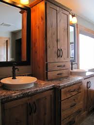 bathroom modern vanity designs double curvy set: bathroom double vanity ideas using rustic wood cabinets and tower cabinet with antique pull handles between large wooden frame mirror under sconce wall lamp