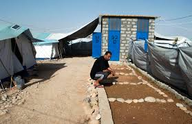 photo essay continually displaced palestinian refugees spend awad s son crouches down beside a plot of land he has been cultivating in the camp