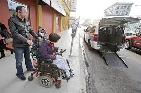 new fight in uber vs taxis transportation san francisco san click to enlarge luxor driver giovanni favognano left helps load wheelchair user fiona hinze on howard street