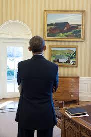 president barack obama looks at the edward hopper paintings cobbs barns south truro barack obama enters oval