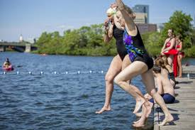 swimmers jump into bostons charles river boston office space charles