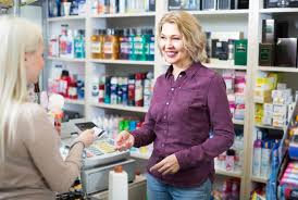 retail sales assistanta pharmacy assistant takes a customer    s cash card