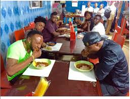 Image result for pictures of adam oshiomole eating local food