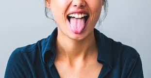 <b>Tongue Scraping</b>: 5 Benefits, Side Effects, Using a Spoon, and More