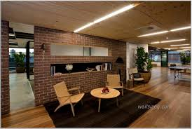 office interior with exposed brick partition style and wooden floor ceiling espresso colored seat cool charming cool office design