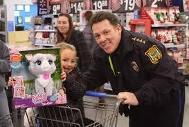 shop a cop treats kids to walmart shopping spree by shop a cop treats kids to walmart shopping spree