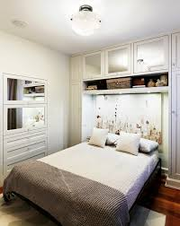 beautiful white small bedroom design with space saving murphy bed with elegant white headboard ornament ith bedding bedroom wall bed space saving furniture
