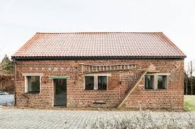 barn conversion studio farris architects belgium green renovation barn renovation brick brick office furniture