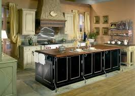 antique design ideas of classic black paint wooden base kitchen island with bronze nickel frame and natural teak solid wood countertops 744x530 antique classic black
