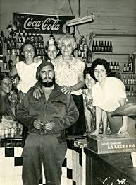 > history > th century > ww > cold war > fidel castro a group of store attendants 13 1961