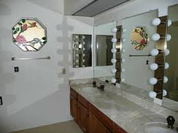 outdated ugly hollywood style vanity lights bathroom phoenix arizona home house for sale bathroom makeup lighting