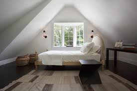 white sloping ceiling attic bedroom style ideas striped cream fabric carpet laminated hardwood floor attic bedroom furniture