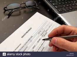 filling health insurance application form stock photo royalty filling health insurance application form