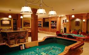heres a large finished basement with gambling tables bar and entertainment area basement sports bar ideas