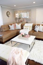 chic living room dcor: refresh your living room with a few key pieces a new throw a couple