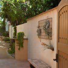 designs outdoor wall art: mediterranean lalsoscaping design completed among outdoor wall art with planter and flowers attached on wall