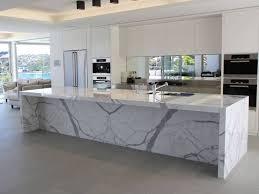 calacatta marble kitchen waterfall: marble nj marble island top with waterfall edge