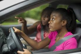 distracted driving teens and what you need to know african american teen learning to drive mom