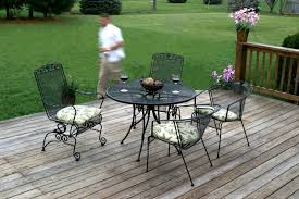 furniture beautiful flowers on wooden fence and awesome iron outdoor furniture with cushions in backyard attractive rod iron patio