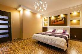 lighting ideas for master bedroom using warm white led light bulbs above king size bed frame above bed lighting