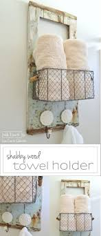 guest bathroom towels: this weathered old driftwood door found on the beach was transformed into this shabby and cute wall organizer and towel holder for a guest bathroom