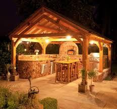 track lighting outdoor kitchen lighting ideas brick stone grill island small tiki bar back bar lighting