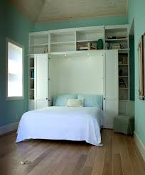 cool small bedroom design with white wall mounted shelf and rack and murphy bed with turquoise awesome murphy bed office