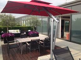 metre giant umbrella: easy to use by single crank handle to simultaenously lower the arm and open the canopy