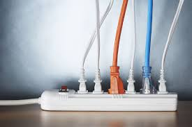 code bathroom wiring:  close up of cords plugged into power strip  feedfcbcef