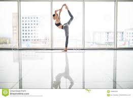 Young Pretty Woman Doing Stretching Exercise On <b>Yoga Mat</b> ...