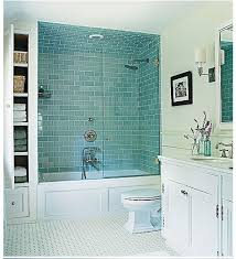 blue bathroom tile ideas: vintage vibe the master bathrooms basketweave tile floor pale blue subway tiled shower and paneled tub create a vintage look in the newly built room