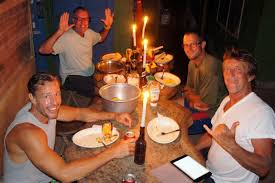heather and scott s adventures group dinner in esterillos new friends brett scott troy rich and jim not pictured the power went out while we were cooking dinner so we ate by