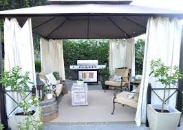 outdoor living room with cabana and grill from centsational girl centsational girl painting furniture