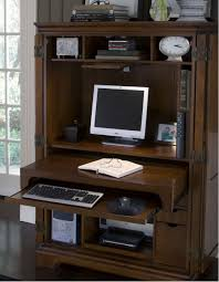 natural brown wood computer armoire with some mini ornaments armoire office