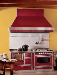 vintage kitchen appliance retro appliances: yellow paint and red retro kitchen stove for decorating in vintage style