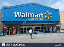 walmart sign stock photos walmart sign stock images alamy exterior view w walking into a walmart supercentre store ontario stock image