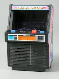 Handheld video game:Cosmic Clash <b>Mini Arcade Game</b> - TOMY ...