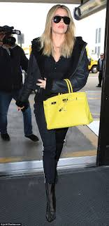 khloe kardashian heads through security at lax daily mail online these boots are made for walkin she finished off her demure look shiny
