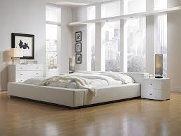 amazing white wood furniture sets modern design: amazing white wooden master bed with bedside table also cabinet feat glasses windows and laminate