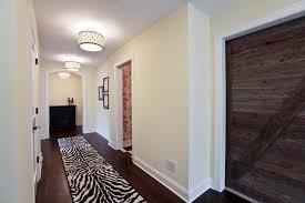 hallway traditional hallway idea in minneapolis with beige walls and dark hardwood floors basement lighting options 1